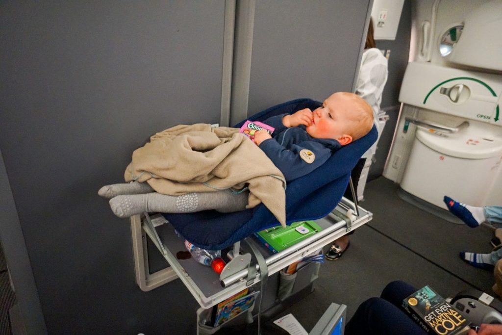 British Airways bassinet seat with baby