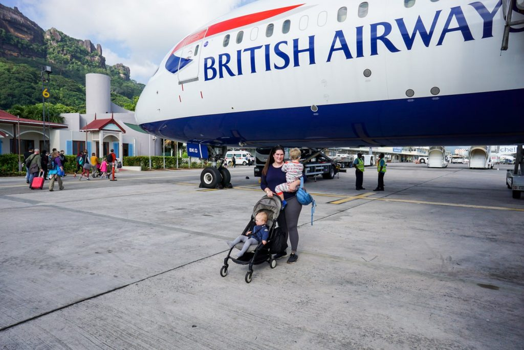 Mother and two children in front of a British Airways 787 in SEZ