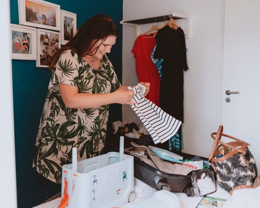 mother packing for child on trip